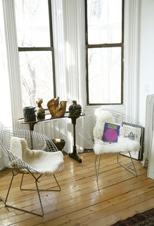 Sheepskin rugs are one of the most popular ways to offset the severity of Bertoia's wire chairs. Here, Sophie Demenge, cofounder of infant brand Oeuf, plays with textures in her kid-friendly home in Brooklyn. See how to utilize sheepskin in your home in this slideshow.