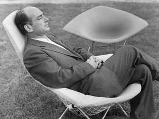 Bertoia, here shown sitting in one of his famous chairs, designed in 1951 for Knoll.