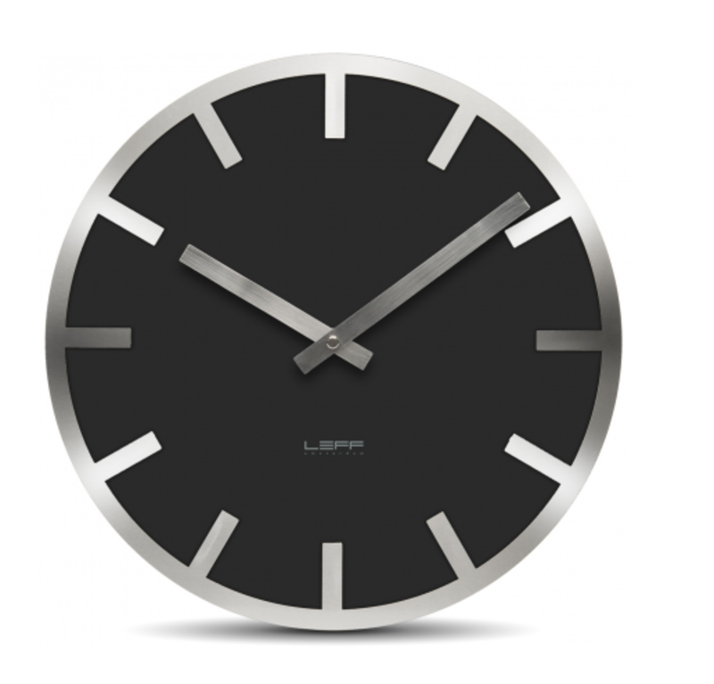Leff Amsterdam's Metlev35 Wall Clock, made of colored glass and aluminum, should help you spring forward in style.