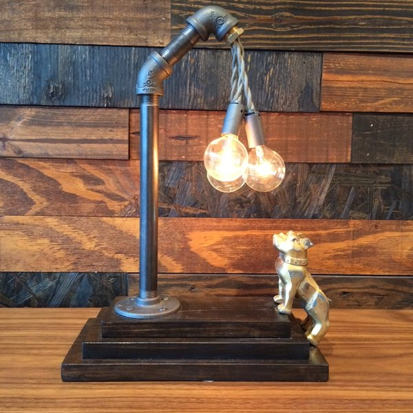 Brass Dog MACK Lamp  Made by a friend of the store, these lamps are made from vintage figurines ( based on the Mack truck bulldog vintage hood ornament), which function as touch-sensitive switches. Unique and fun, it's both classical and quirky.