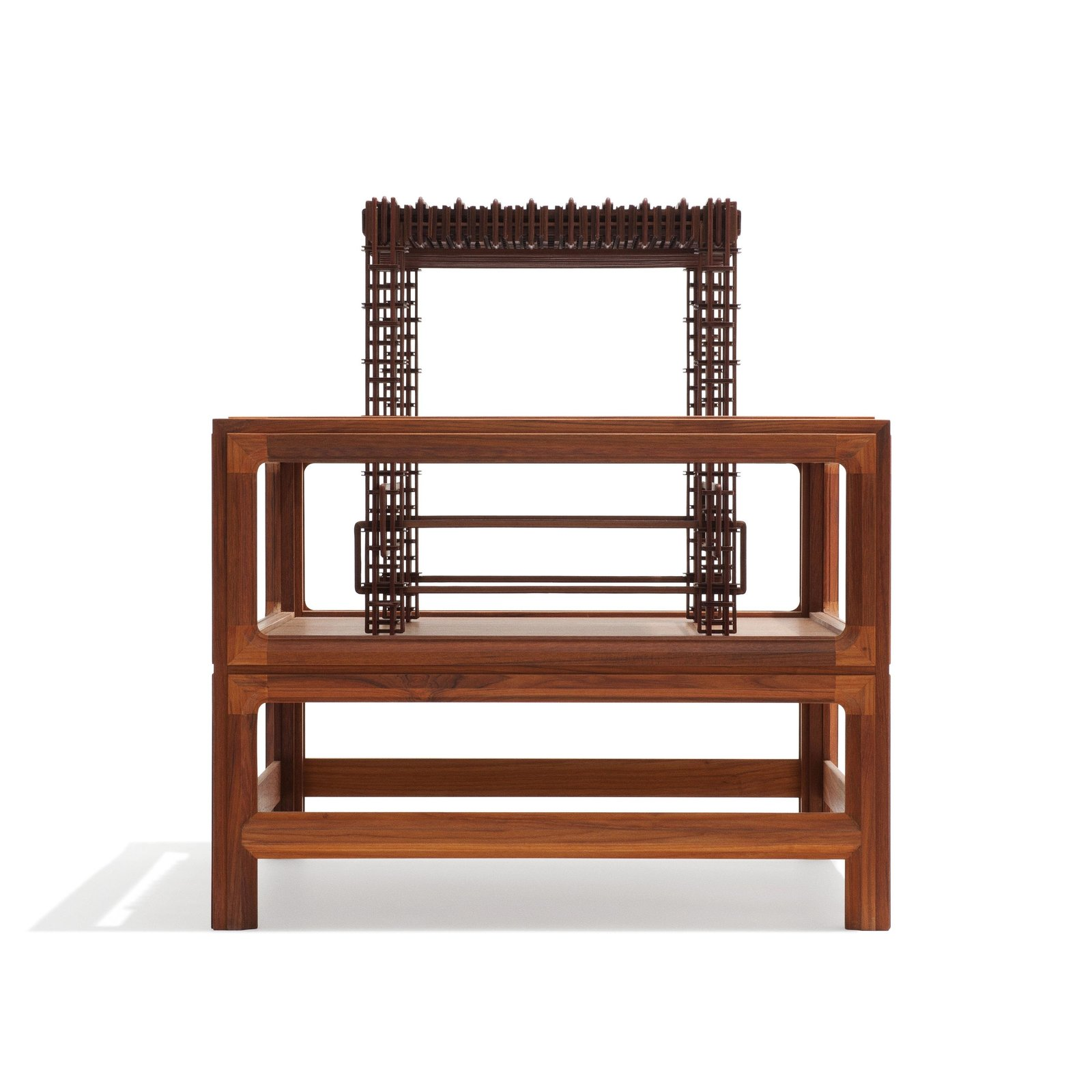"""Completely Dusty by benandsebastian was built to infuriate the cleaner with grooved walnut latticework and leather bindings designed to harbor dust (Shown here on top of its display case).  Search """"diningfurniture--stools"""" from Danish Mindcraft at Ventura Lambrate in Milan"""