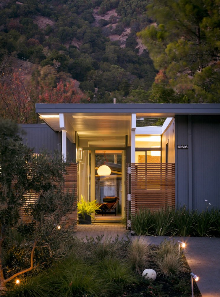 Exterior, Mid-Century Building Type, and House Building Type The 1,570 square-foot home's entryway features a slatted fence that diffuses light and adds privacy to Eichler's original design. Photo by: Scott Hargis  Modern Eichler Renovations by Allie Weiss