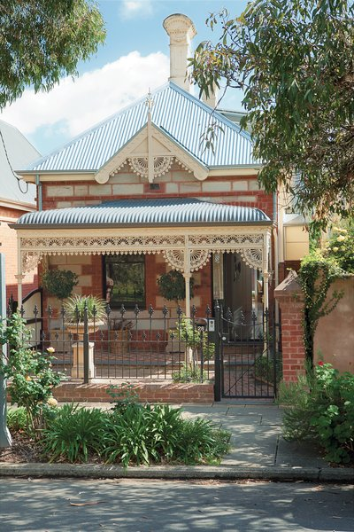 Brammy and Kyprianou hardly touched the front of their house, an 1880 sandstone and brick Victorian with galvanized iron ornamentation.
