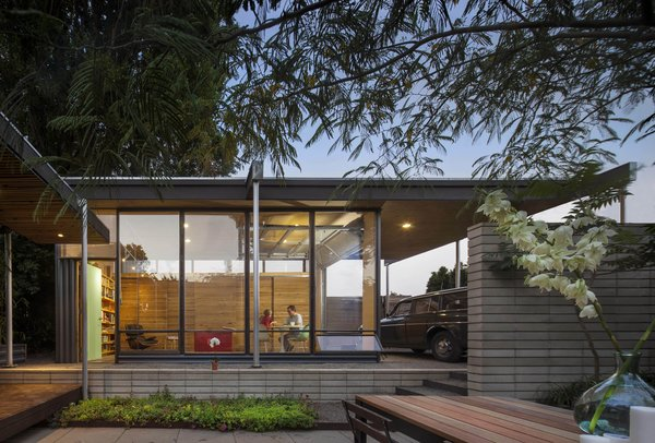 The studio addition is part of a revamp that unifies buildings, canopies, and the courtyard. It was a three-year job for architect-owners Matt Wittman and Jody Estes, with many materials opportunistically salvaged.
