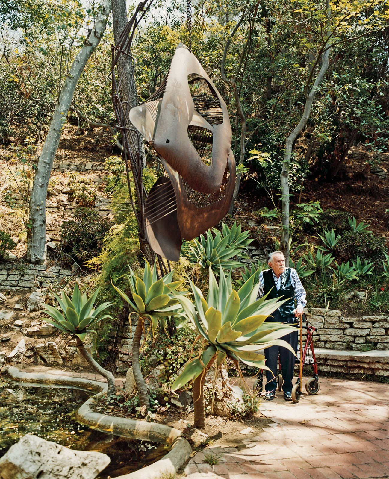 """No landscape architect would do this mishmash,"" says Shulman of his beloved garden. ""Behind my land is 53 acres, which now belong to the Santa Monica Conservancy, so it's protected,"" he says. ""My daughter's son will probably live here when he grows up—he's only 25 or 30 now."" Though the photographer uses a walker—dubbed ""the Mercedes""—to maintain his balance, he claims to have given up skiing and backpacking in the Sierras only a few years ago.  Photo 4 of 4 in True Hollywood Story"