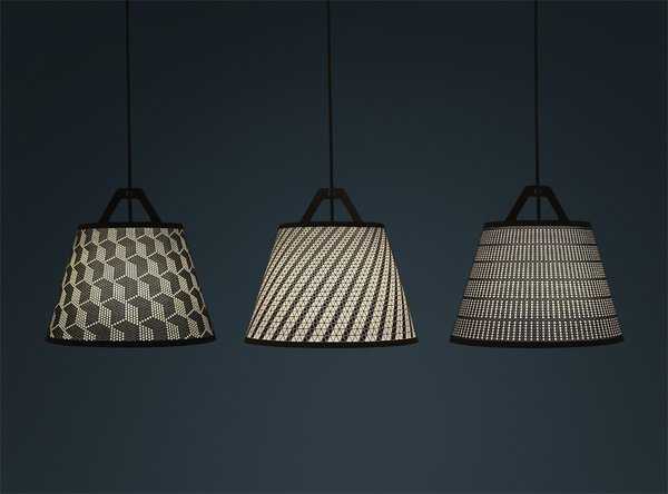 """German designer Maximilian Schmahl created the DIY beacon while considering the philosophy behind his new fifti-fifti label, making a equal connection between the object and the customer. """"I wanted to make a product you can customize, something that gives you joy while using it, a vibrant product,"""" he said. """"I started to experimenting with perforated paper and it was just perfect to design a lamp with it. The owner can decide for him or herself where the light comes through the shade."""""""
