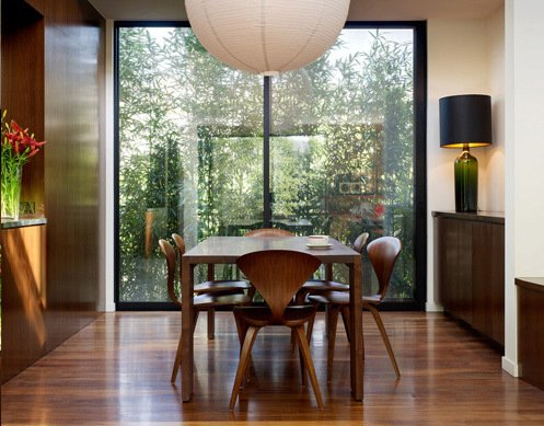 This dining room features the Cherner Chair alongside a dining room table designed by Benjamin Cherner.