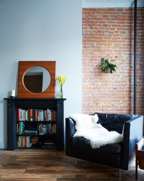 The key to making any space feel large is finding clever places for storage. In Dealtry and Barry's place, the architects designed bookshelves in old fireplaces.