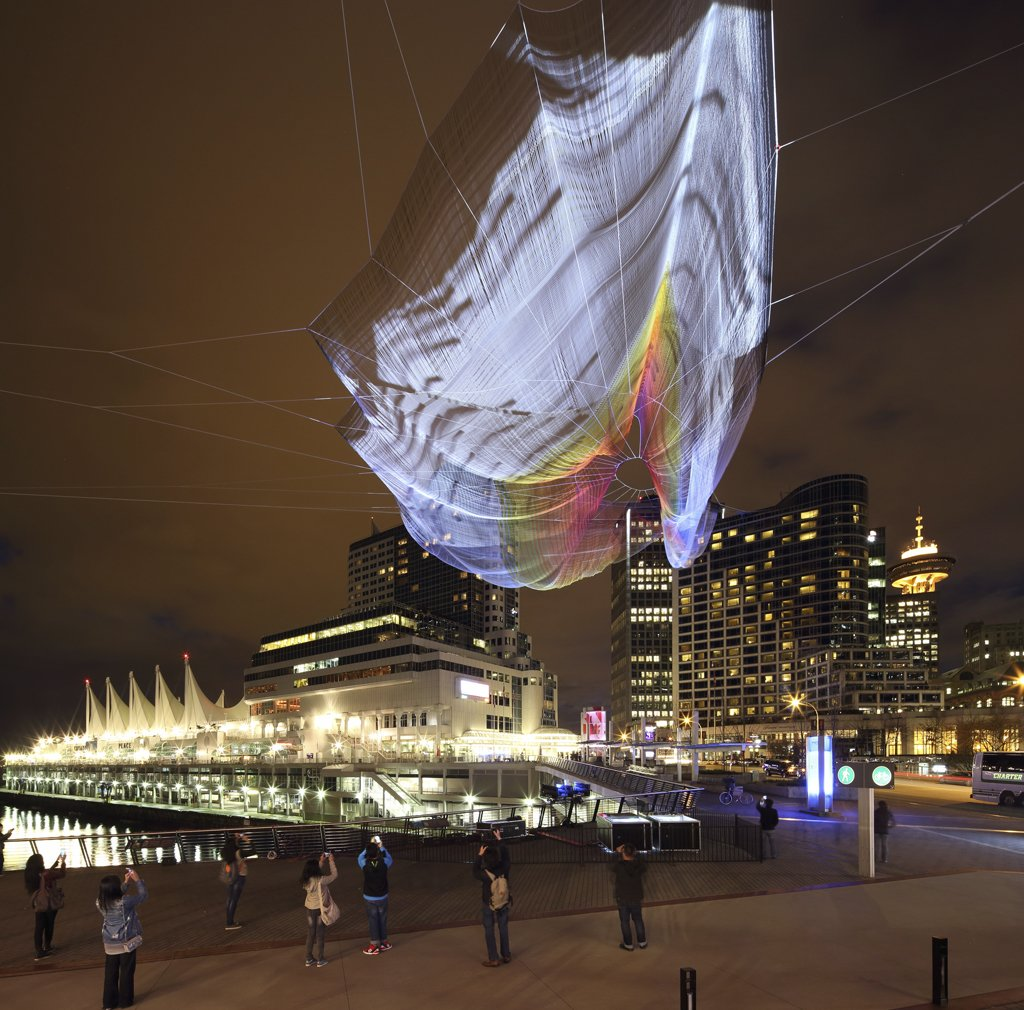"""Janet Echelman's """"Skies Painted with Unnumbered Sparks""""  An interactive installation that hung above Vancouver in March, this piece can withstand wind from a Category One hurricane.  Credit: Ema Peter  Photo 2 of 4 in Sculpture Lets the Public Paint the Sky"""