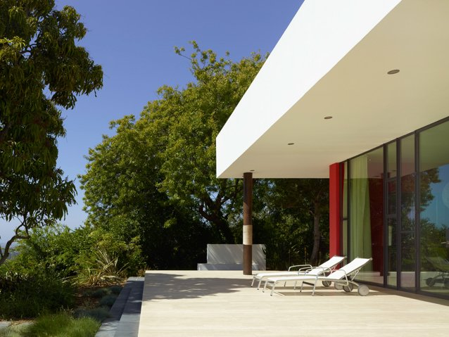 On the sunset side of the Sunrise house, the home's west terrace is shaded by mango trees.  Photo 8 of 12 in 5 Reasons Why Landscaping and Bringing Plants Into Your Home Is So Valuable from Sustainable, Solar-Powered Family Retreat in California