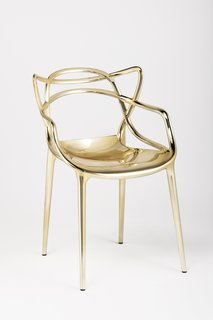 Designer Philippe Starck's gold rendition of his Masters Chair for Kartell. See it at Salone, booth Pavilion 20, Stand A15/B14.