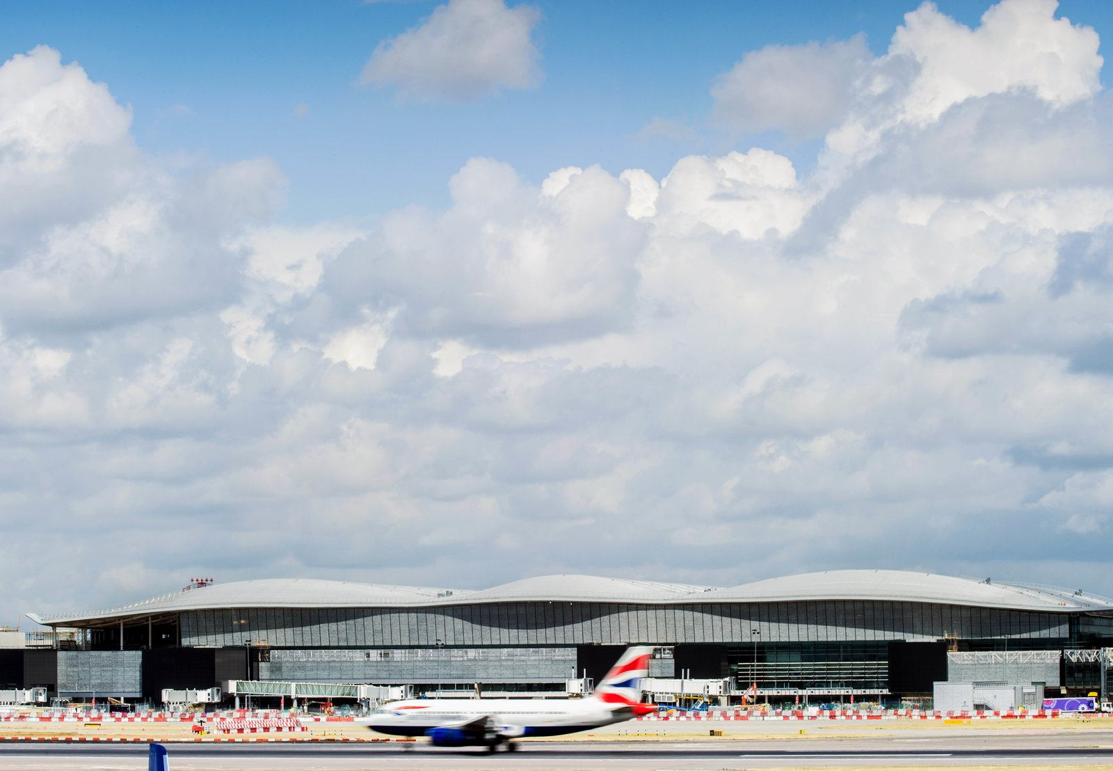 An exterior view of Terminal 2 at Heathrow Airport near London, designed by Luis Vidal + Architects, which opened in June 2014. The $4.15 billion terminal is expected to handle 20 million passengers a year.  Jet Set: 8 Modern Airport Designs by William Lamb from Exhibit Spotlights the Work of Spanish Architect Luis Vidal