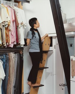 """The stairway to the sleeping loft is a riff on a ship's ladder: """"We spent a lot of time figuring out how much space we need to maneuver,"""" says David. """"It allowed us to make it as small and perfect as we wanted to."""" Instead of a handrail, sail cleats are bolted to the walls as hand-holds."""
