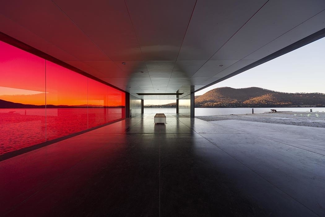 """From the southern approach, you head toward a tunnel; every step tells you that you know what you are going to experience and then suddenly upon arrival, there is an enormous wall of red glass—it seems incomprehensible that you did not know it was there all along,"" Bailey says.  A Dramatic Viewing Platform in Tasmania by Diana Budds"