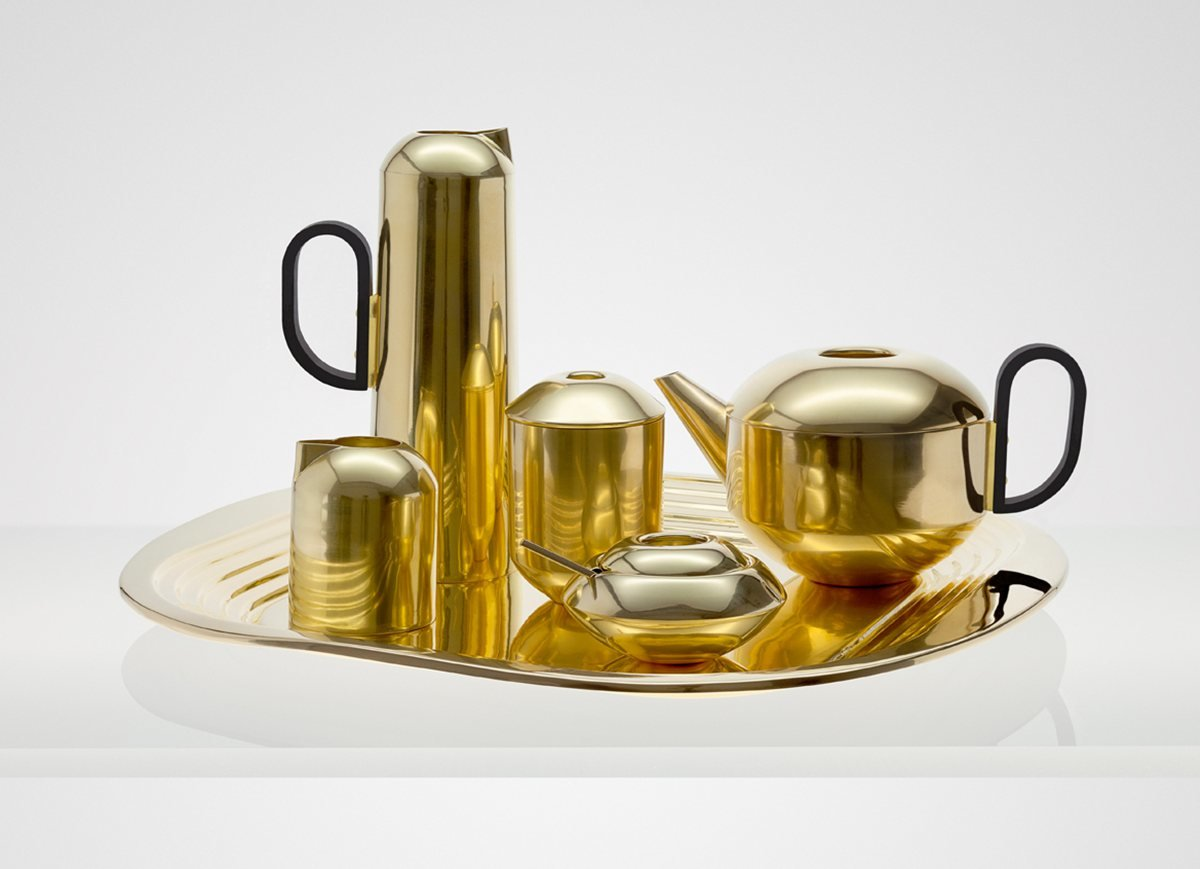 """Form Brass Tea Set by Tom Dixon  """"It has the feeling of a classic, streamlined Art deco tea set. I love that it's being made now by craftsman in India. It looks beautiful on the table with the tray. I love the feeling, I think of it having 360-degree bleacher seating around it, the pieces just brings the eye in so well, like they're in an arena or piazza. There's a beautiful architectural sensibility to them. But you don't have to overthink it, it just works.""""  Photo 4 of 11 in Shops We Love: Propeller Modern"""
