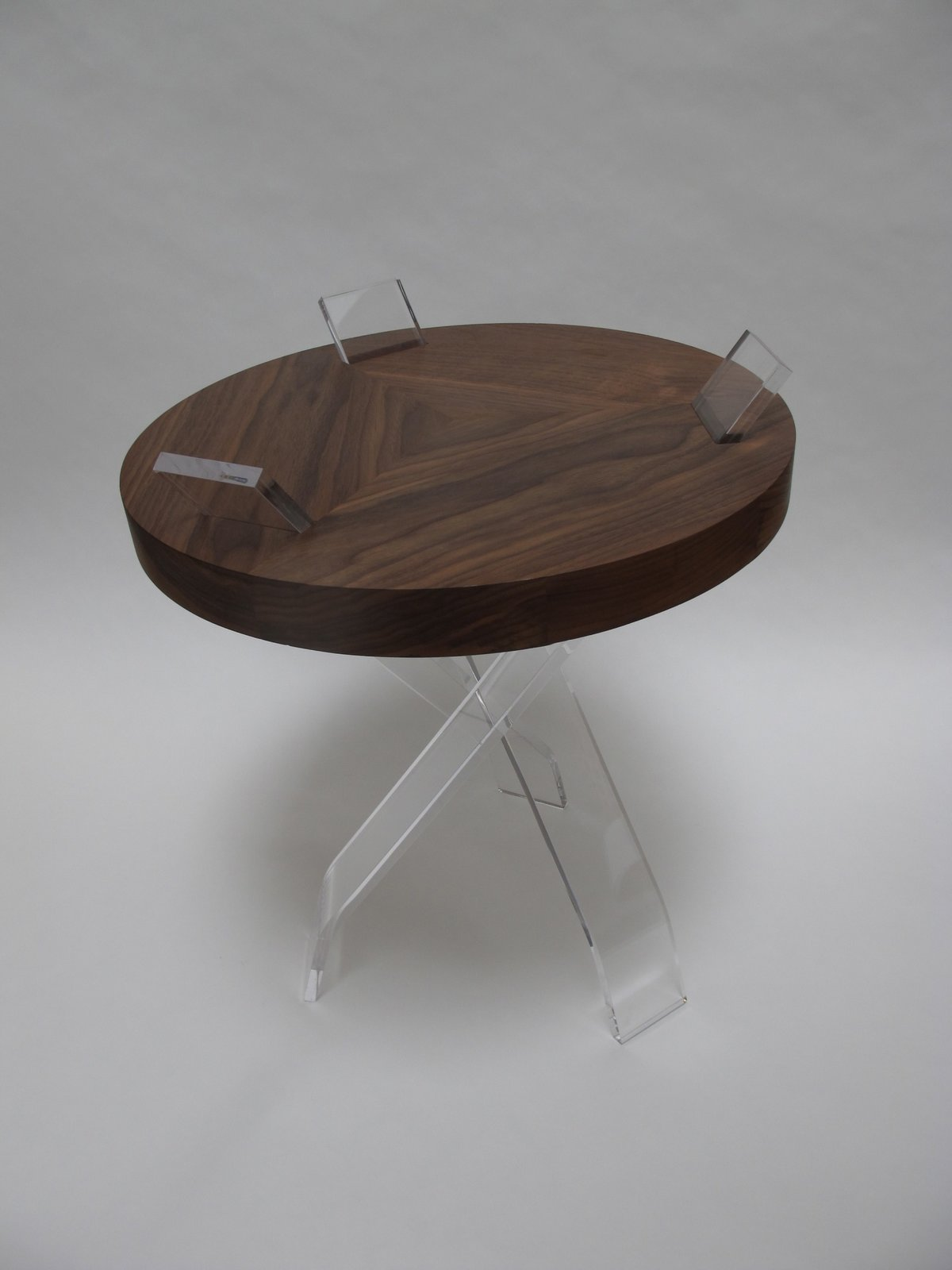 """Campaign Table by William Earle  """"William's piece has three legs, and there's just a way the components interact with each other. It's very unique. I like a piece that can do something a little bit differently, but maintain an integrity and accessibility.""""  Photo 10 of 11 in Shops We Love: Propeller Modern"""