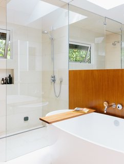 The master bath is a bright sanctuary with a freestanding tub by Victoria + Albert and Ecostat shower fixtures by Hansgrohe.
