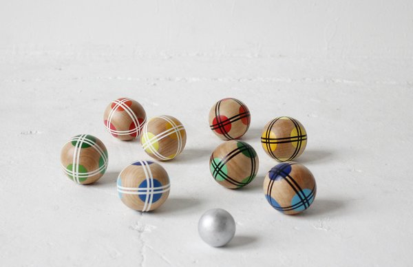 These hand painted wooden balls make Bocce, a game with roots going all the way back to the Roman Empire, an excellent contemporary pastime for children and adults alike.