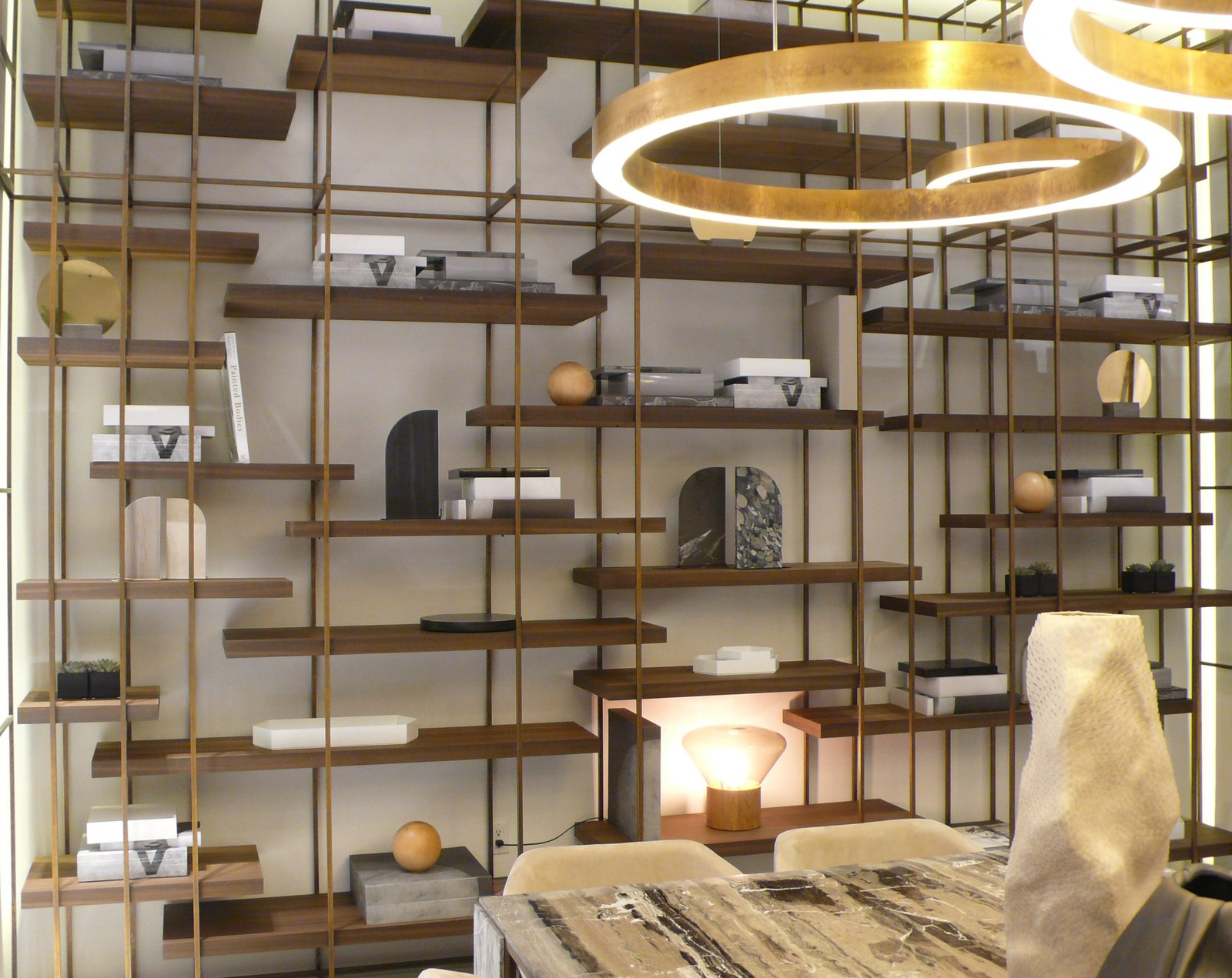 A Henge Cage B shelving system and pendants.  shelves from A New Modern Showroom Opens in Los Angeles