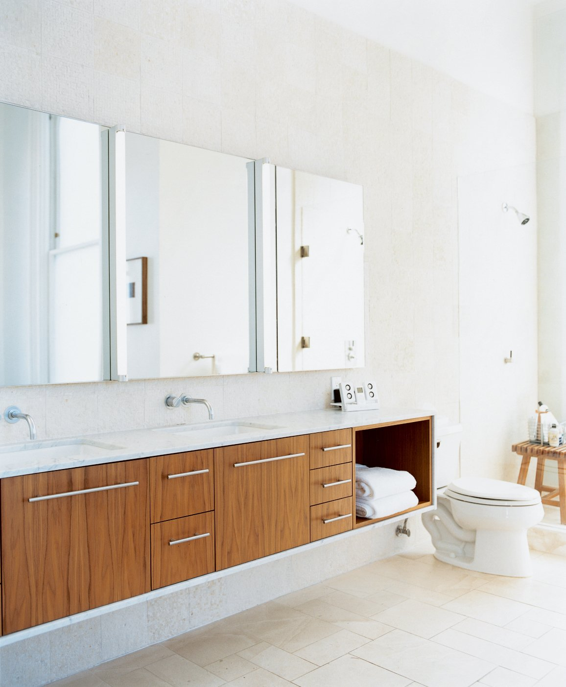 Bath Room and Wall Mount Sink The master bathroom used to be a tiny kitchen in what was once a tiny apartment. The cabinets were designed by Nilus de Matran and fabricated by George Slack.  Bath Reno from Taking Liberties