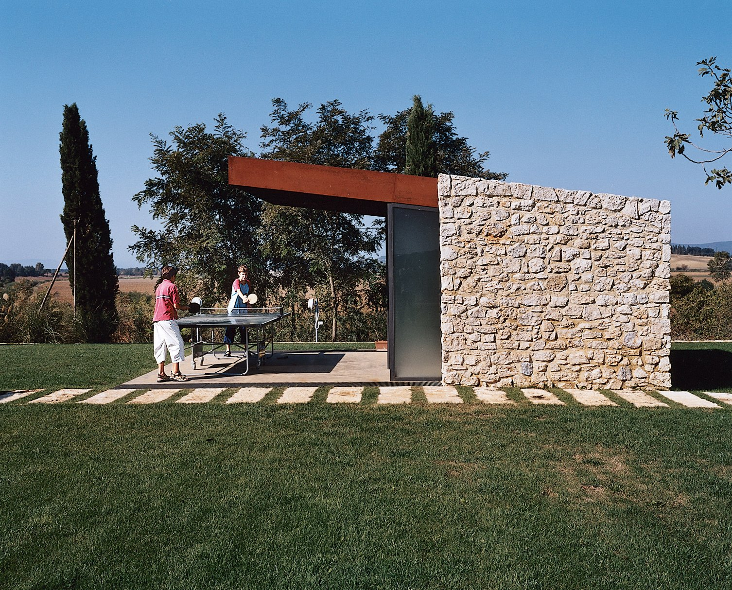 Shed & Studio and Living Space Room Type Podere 43 allows for an endless array of leisure activities like ping-pong.  Modern Italian Renovations  by Matthew Keeshin from Somewhere Under the Tuscan Sun