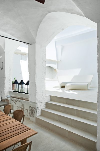 This serene retreat by acclaimed Italian designers Ludovica+Roberto Palomba, carved out of a 17th-century oil mill in Salento, demonstrates the charm of historic Italy.