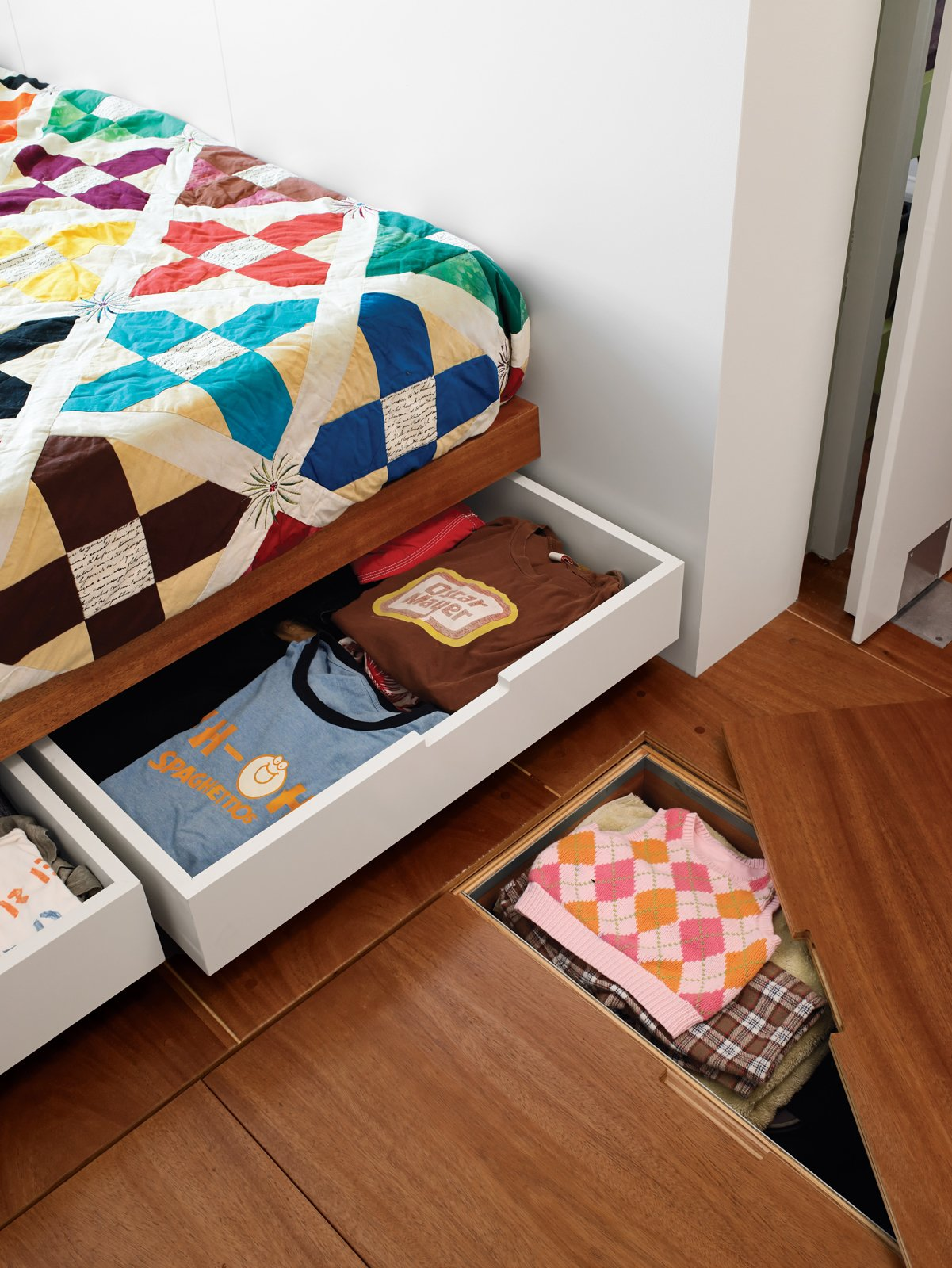 Storage Room Storage under the bed and floor hides clutter in the master bedroom.  Surprising Clothing Storage Solutions by Jaime Gillin from Storage-Smart Renovation in New York City