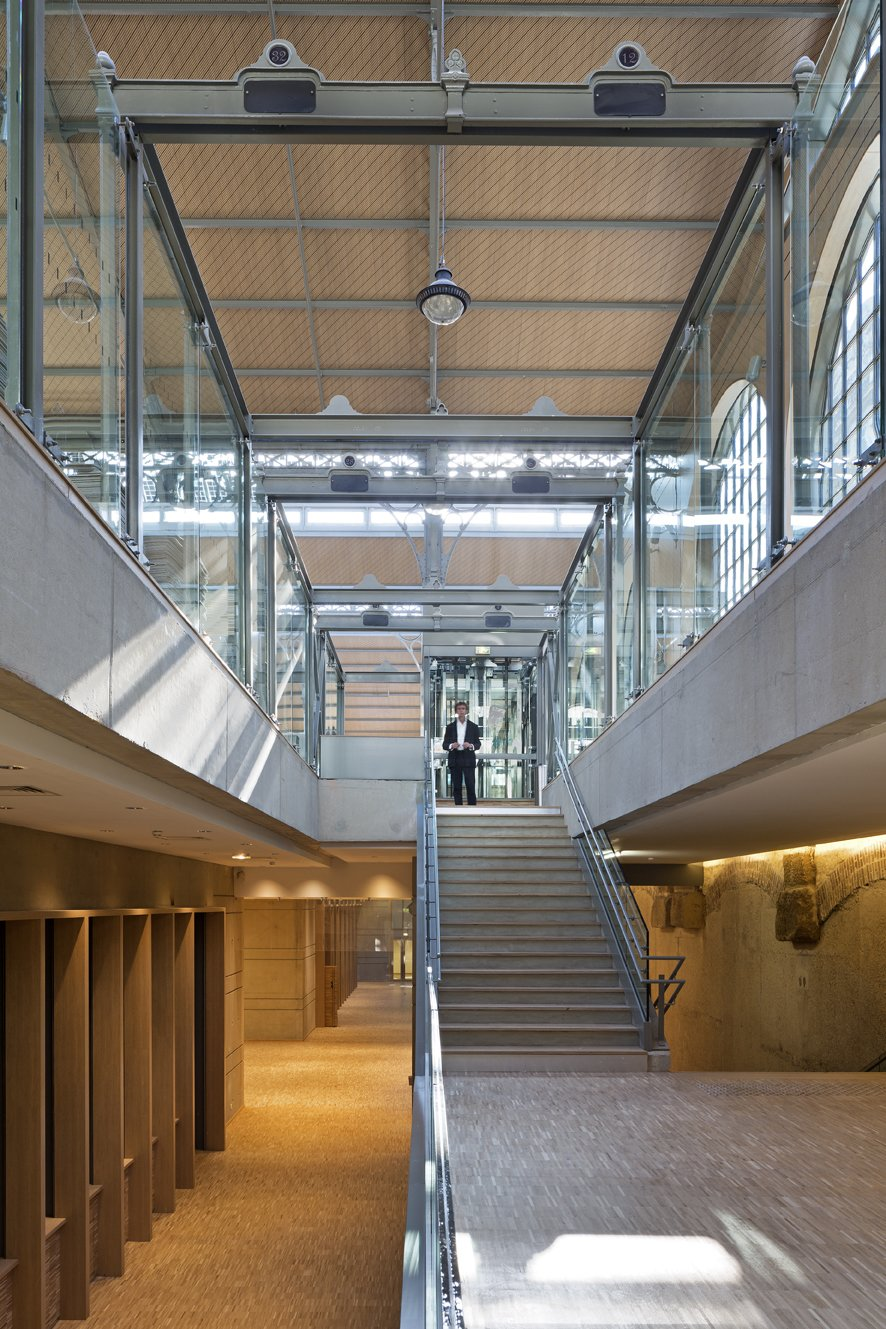 Carreau du Temple's Main Level and Basement  With the addition of a bi-level basement containing all the working elements of the structure, the ground-level mezzanine remains unencumbered and adaptable.  Photo Credit: Fernando Javier Urquijo/studioMilou architecture.  Photo 7 of 9 in Carreau du Temple: Parisian Poetry in Glass and Steel