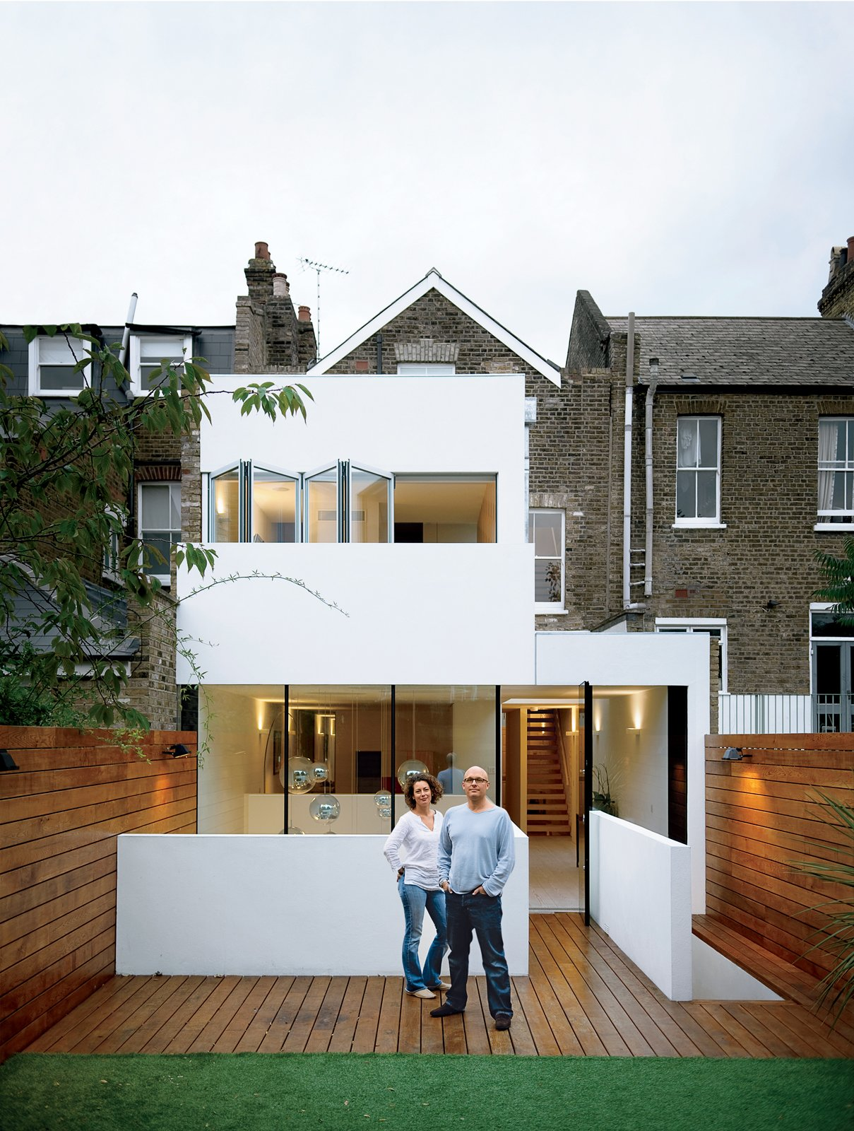 Outdoor, Small, Back Yard, and Wood Bruce Thatcher and Kirsty Leighton behind their London home.  Best Outdoor Back Yard Wood Photos from Composite Index