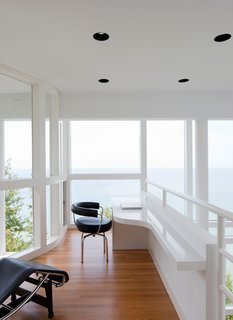 The office, which overlooks the main living space, is situated as if it's the prow of a ship.