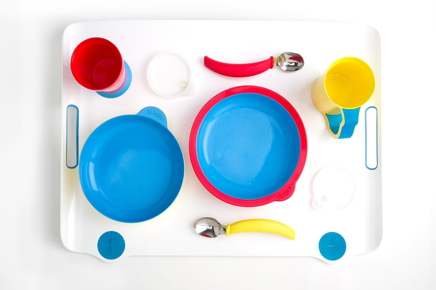 This seven-piece tableware set designed by Sha Yao for Alzheimer's patients includes anti-slip bowls, anti-tipping mugs, and curved spoons.  Photo 1 of 5 in Designs for patients with dementia
