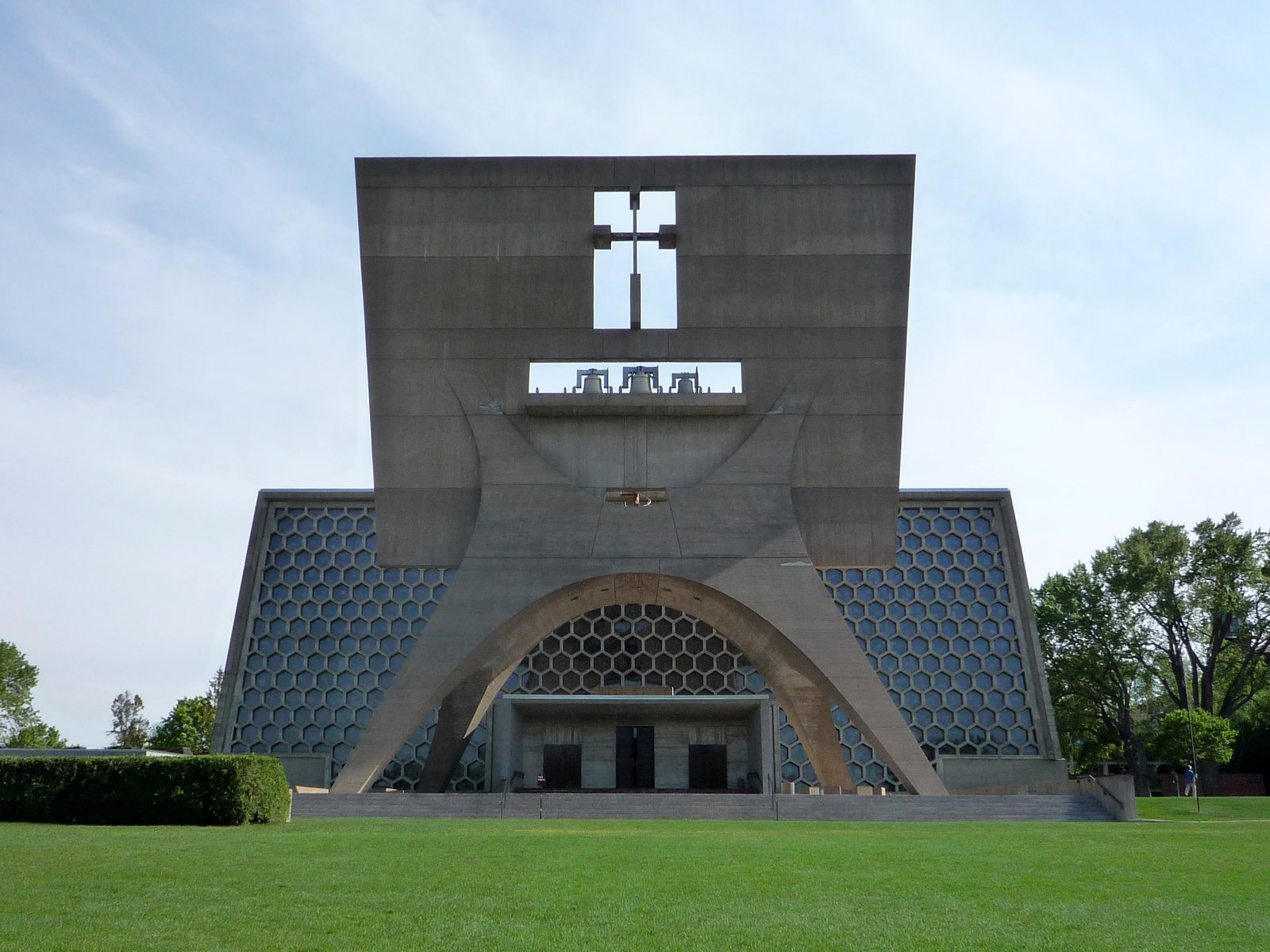 Church at St. John's Abbey (Collegeville, Minnesota, 1961)   In 1950, Abbot Baldwin Dworschak solicited forward-thinking designs from leading architects to remake his Minnesota church and create a monument to the service of God. Breuer answered the call. There's a certain majesty to the bell tower greeting the faithful, a massive panel supported by a curvaceous stand. That Breuer then follows it up with the church itself, with a massive wall of hexagonal stained glass and concrete tresses, makes this a classic.  Photo Credit: Wikimedia Commons  Photo 7 of 12 in Design Icon: 10 Buildings by Marcel Breuer