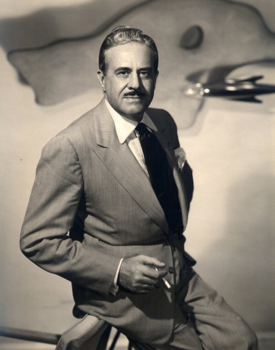 "According to daughter Laurence Loewy, the stylish and talented designer liked ""a stiff drink, a good smoke, and a hearty laugh.""  Photo 2 of 10 in Design Icon: 8 Works by Raymond Loewy"