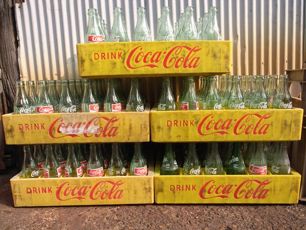 "According to the Coca-Cola company, Loewy did not redesign the contoured bottle created by the Root Glass Company in 1915, which he called ""the most perfect 'fluid wrapper' of the day and one of the classics in packaging history."" He did, however, rework different versions of the bottle, as well as retool a variety of packing and promotional material for the soft drink giant, including soda fountains, coolers and delivery trucks."