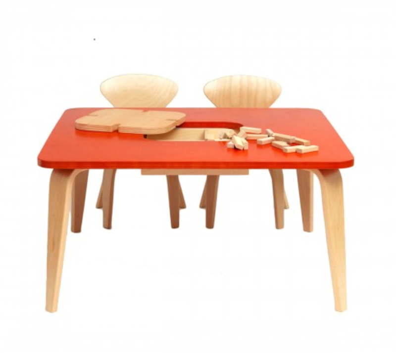 Available in the Dwell store, the Cherner Children's Table with Storage is a sturdy and supportive workspace made of molded birch plywood and laminated birch.