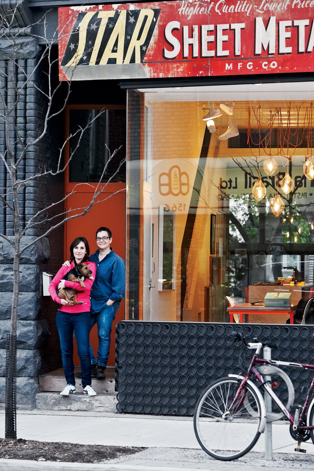 """Exterior, House Building Type, and Glass Siding Material Architect Tamira Sawatzky and artist Elle Flanders get an awfully good view of their busy Toronto street from their office and dining room.  Search """"the work of asher israelow"""" from Don't Let the Sign Fool You, This Old Storefront is a Home"""