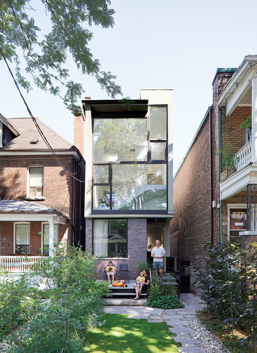 Outdoor, Grass, Pavers, and Small Karen White, David MacNaughtan, and their sons, Griffin and Finlay, hang out on the front deckof their narrow home in Toronto's leafy Roncesvalles neighborhood. A narrow modernist composition of glass panes and purple brick, the house slips like a bookmark between two older buildings, a bright three-story abode on a lot narrower than most suburban driveways.  Photo by Dean Kaufman. Read more about the small house here.  Best Outdoor Pavers Grass Photos