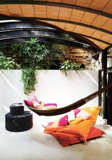 At one end of the space, which is topped by a barrel ceiling, a hammock offers a tantalizingly cozy place to nap.