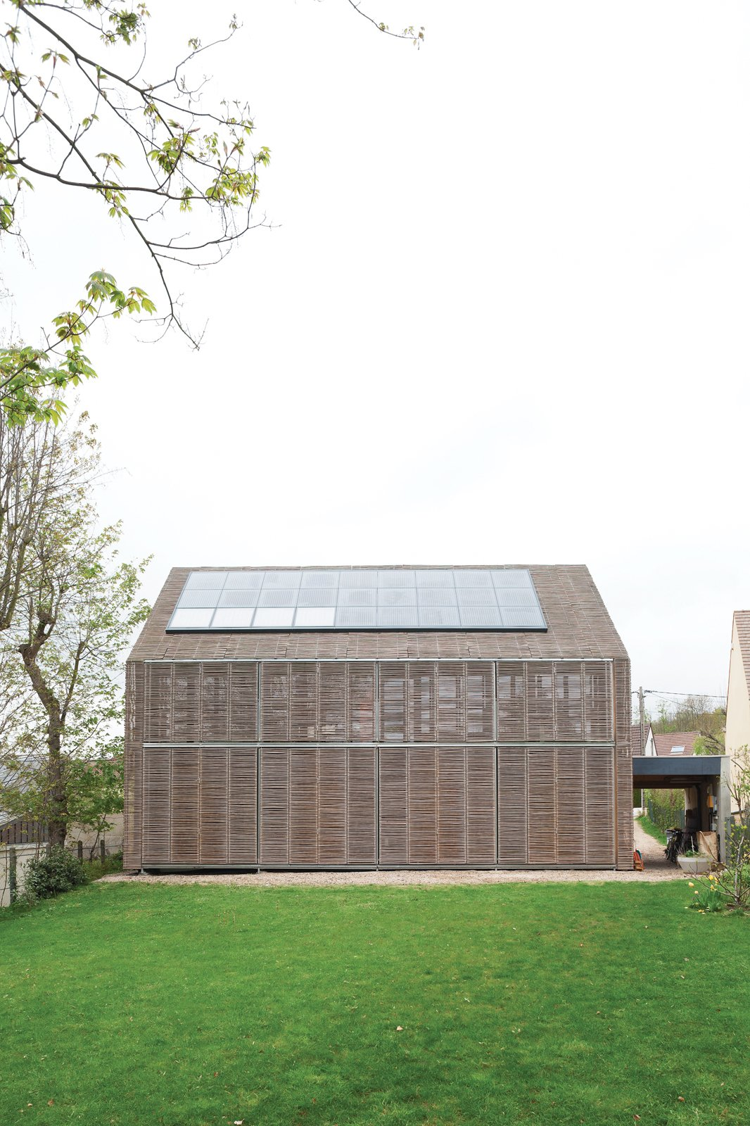 Passive ProgressiveStunning bamboo covers this house in Bessancourt, France, on all four sides, its lattice making up a striking set of adjustable screens that allow the residents to modify the facade to suit the weather. Photo by: Nicholas Calcott  Photo 1 of 8 in Passive Progressive