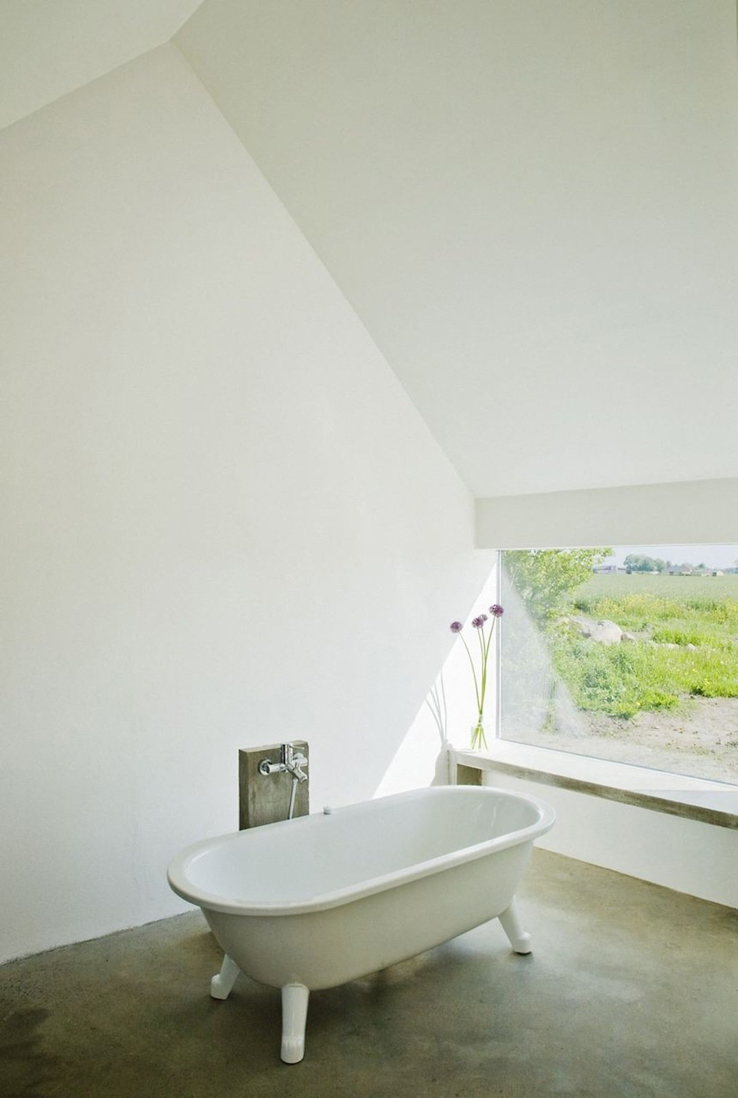 """The original washing house connected to the main house was in such bad shape that it had to be demolished. LASC """"reincarnated"""" it as a spacious bathhouse, complete with a tub‐with-a-view and a heated concrete window bench. Photo by Laura Stamer.  Baths from How to: Designing for Warm Weather"""