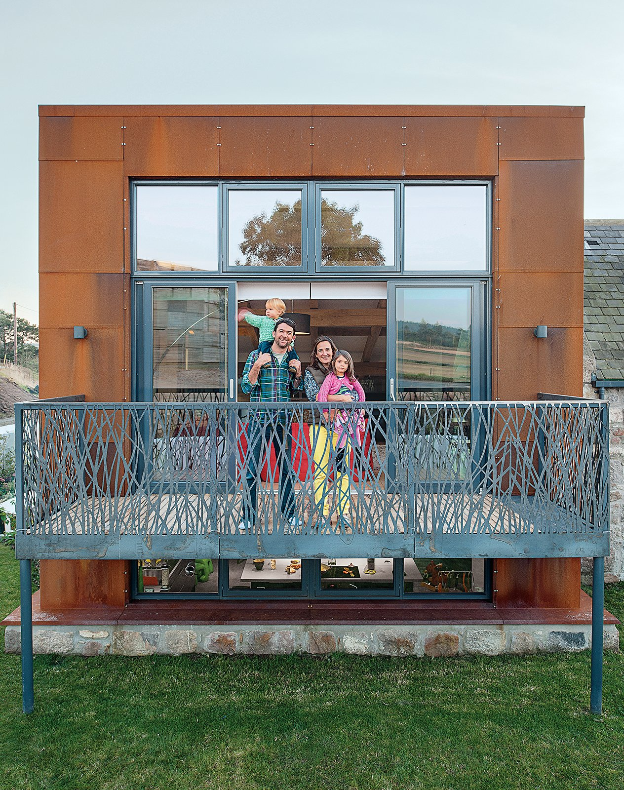 Exterior, Metal, House, and Farmhouse Architect Andrew McAvoy created an earth-sheltered house in Scotland for Gavin and Angelique Robb and children Scarlett and Gus.  Exterior Metal Farmhouse Photos from This Farmhouse is a Cor-Ten Steel-Clad Dream