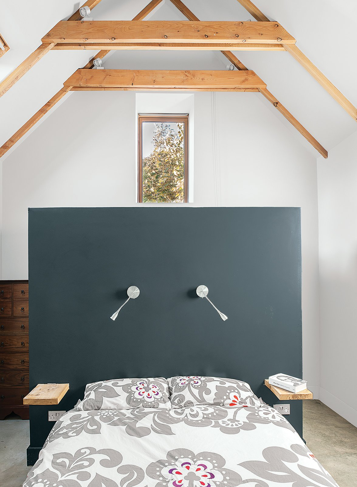 Bedroom, Bed, and Wall Lighting Designer Sue Macintosh chose the Farrow & Ball Off-Black paint for the master bedroom.  Bedrooms by Dwell from This Farmhouse is a Cor-Ten Steel-Clad Dream