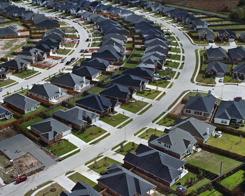 Outside of Houston, Texas, houses line parallel, curved streets. Photo by Christoph Gielen.  Photo 2 of 5 in Suburban Sprawl Photographed from Above