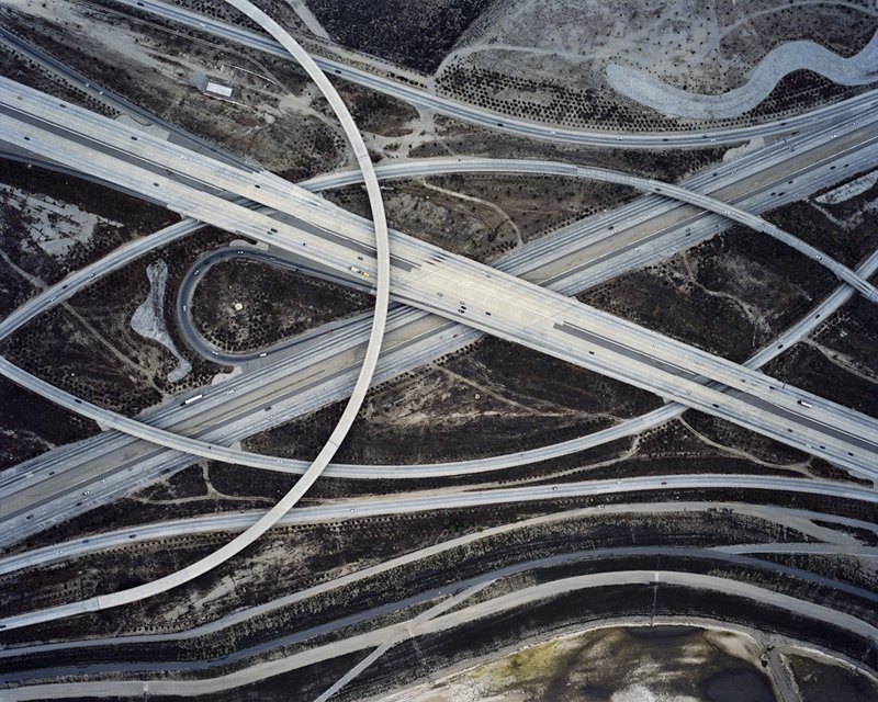 A freeway interchange in Southern California casts sweeping arcs over the terrain. Photo by Christoph Gielen.  Photo 5 of 5 in Suburban Sprawl Photographed from Above