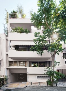 The 1,292-square-foot split-level apartment occupies the top two floors of a building in central Athens that was completed in 1995. The apartment's configuration allows for four balconies and panoramic views of the city and its tallest natural feature, Mount Lycabettus.