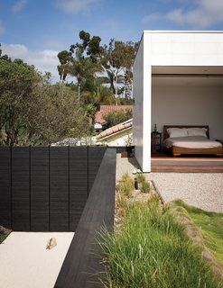 The limestone-clad volume at the east end of the house extends to the second story, housing Shino and Ken's master suite, which opens onto the planted roof deck.