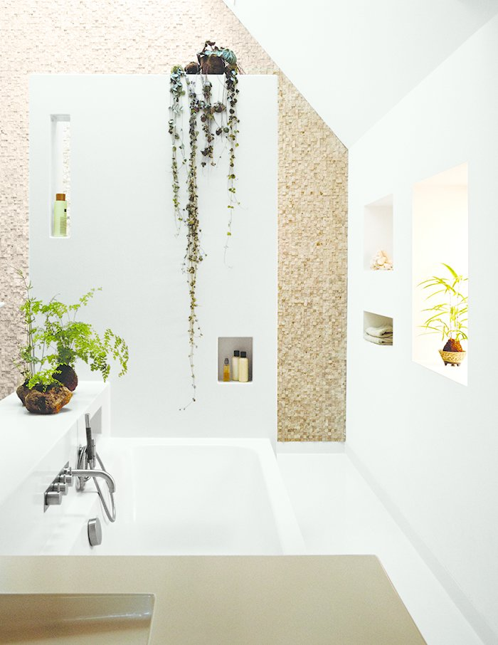 Bath Room and Open Shower Amending Meeuwissen's early request for an open bathroom space, the architects devised a more private chamber with an overhead skylight and walls in stone tile from Intercodam Tegels.  Bathrooms from A Soaring Schoolhouse in the Netherlands is Reborn