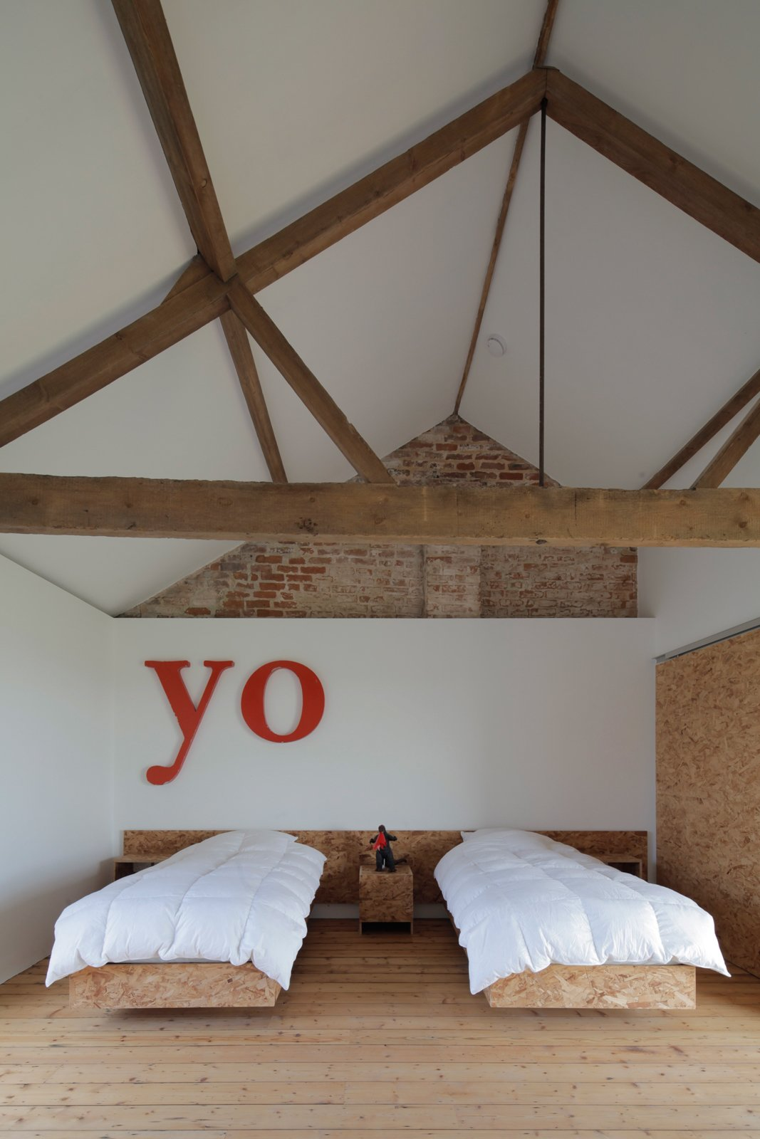 "Bedroom and Bed A guest room in this repurposed barn in the English countryside lets the ceiling do the talking. Photo by Christoffer Rudquist.  Search ""mvrdvs balancing barn"""" from A Pair of English Barns Hide Unabashedly Bold and Budget-Friendly Minimalist Interiors"