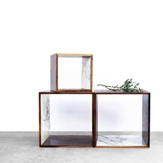 The Walnut and Marble Storage Cube from 2131 takes the simplicity of a box and elevates it with rich walnut wood and luxe marble. The cube includes one interior surface that has been inlaid with Italian Calacatta Gold marble, which elegantly frames the storage cube's contents.