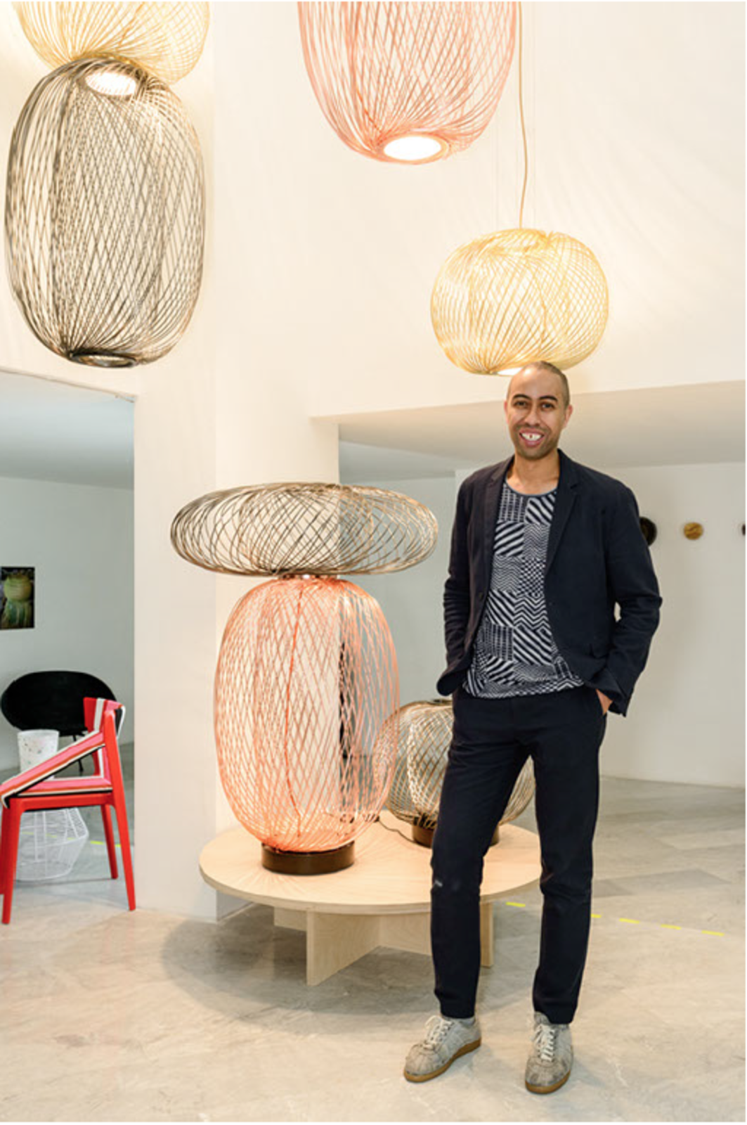 Burks, standing with his Anwar LED lighting collection for Parachilna, at his Dwell-hosted Man Made exhibition in Milan.  60+ Modern Lighting Solutions by Dwell from Dwell Presents Stephen Burks Man Made in Milan